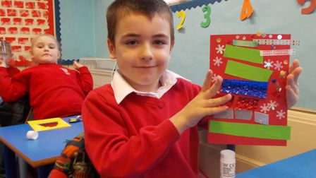 Pupils at St George's Primary with their Christmas cards.