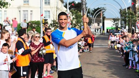 Queen's Baton Relay hits Lowestoft - carried by Anthony Ogogo.