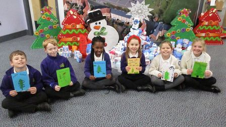 Children at Queen's Hill Primary School, in Costessey, have used drawing, colouring and sewing to make cards for care home...