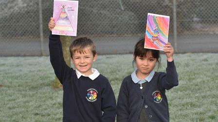 Children at Thomas Bullock Primary Academy School making Christmas cards for residents.