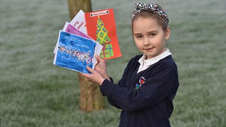 Christmas cards designed and drawn by children across Norfolk's schools are handed out to residents