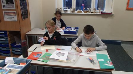 Pupils at St Faiths Primary School making Christmas cards for care home residents and staff.