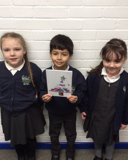 Pupils in class 2Y at St Williams Primary School with their Christmas cards.
