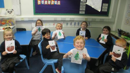 Pupils in the panda class at St Williams Primary School with their Christmas cards.