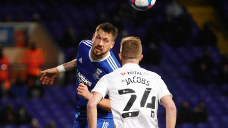 Ipswich Town captain Luke Chambers heads clear against Portsmouth