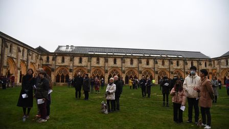 People watch the Carols in the Cloisters concert at Norwich Cathedral.