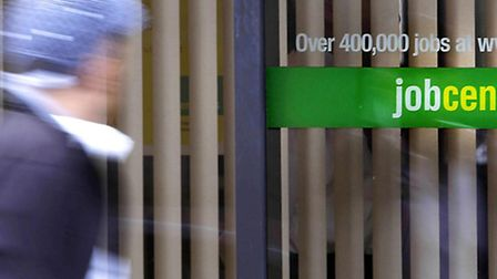 A person passing a Job Centre Plus as the jobs outlook is at its strongest level since the recession
