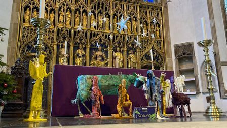 The nativity crib at St Peter Mancroft Church, Norwich, created from recycled household materials and newspaper headlines...