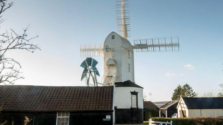 Saxtead Green Mill post mill with three storey roundhouse. The mill has four Patent sails carried