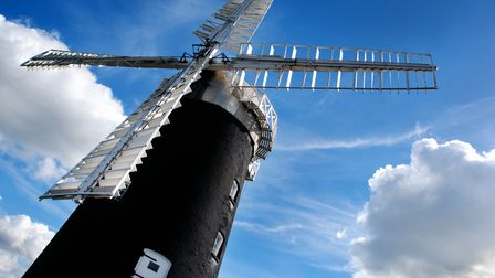 Abstract angle of Pakenham windmill in Norfolk on a beautiful sunny day with clouds in the backgroun