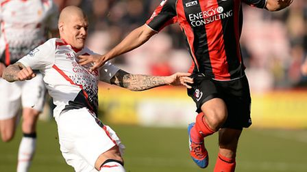 Liverpool's Martin Skrtel (left) and AFC Bournemouth's Lewis Grabban battle for the ball during the