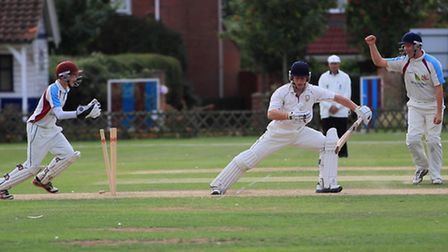 A Stow batsman is bowled out last season against Fakenham. Picture: Ronnie Heyhoe
