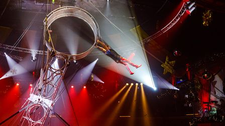 Circus performer Svilen hangs from the Wheel of Death act at the Great Yarmouth Hippodrome Circus