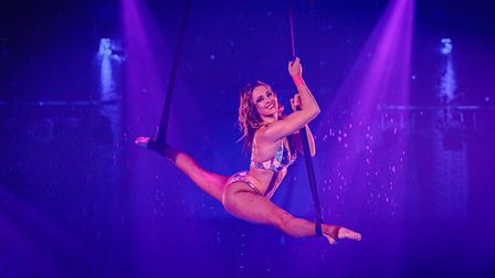 Circus performer Sarita Macaggi on the aerial straps above the pool at Great Yarmouth Hippodrome Circus