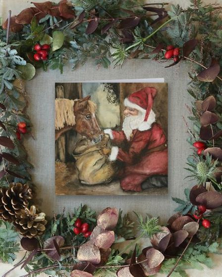 front of Christmas card with illustration of Santa and Shetland pony