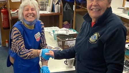 Jenny Ellis delivering the presents to Ann Matthews (left), manager of the Salvation Army charity shop in Chatteris.