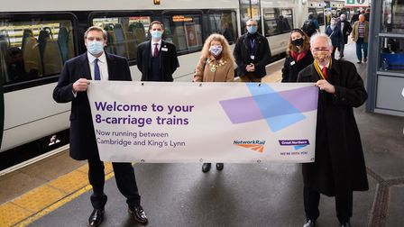 Welcoming the eight-carriage train from King's Lynn at Cambridge are (left to right) James Palmer Maypr of the...