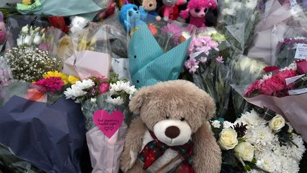 Floral tributes at the scene of a house fire on Buttercup Avenue, Eynesbury, Cambridgeshire, in which a three-year-old boy...