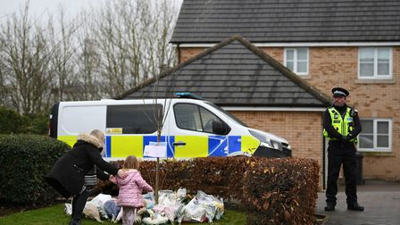 Floral tributes are left at the scene of a house fire on Buttercup Avenue, Eynesbury, Cambridgeshire, in which a...
