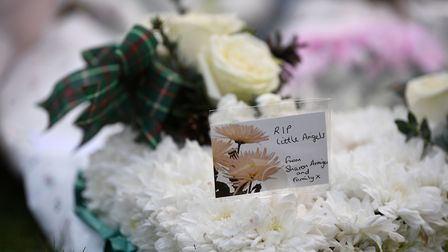 Tributes left at the scene of a house fire on Buttercup Avenue, Eynesbury, Cambridgeshire, where a three-year-old boy and...