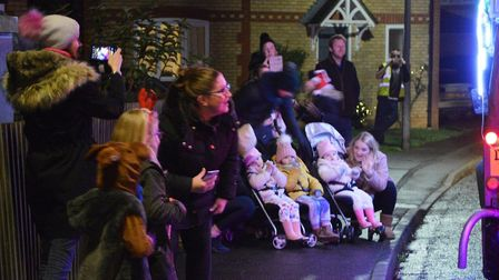 Santa returned to Doddington this year as part of his annual tour through the village, as residents turned out in force...