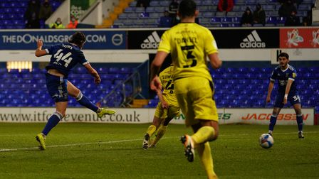 Armando Dobra wants the ball as Emyr Huws takes a second half shot from the edge of the box.