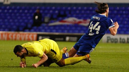 Emyr Huws is taken down by Colin Daniel, who was given a yellow card for his challenge.