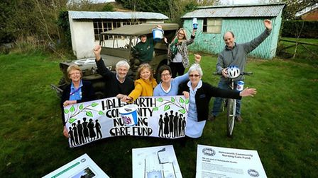 Some of the Information and Support Centre fundraising committee on the land in Halesworth earmarked