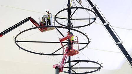 Engineers install the Emergence, made and designed by Wymondham-based Polar Manufacturing at Heathro