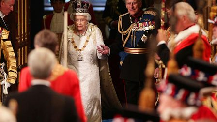 Queen Elizabeth II and the Duke of Edinburgh proceed through the Royal Gallery during the State Open