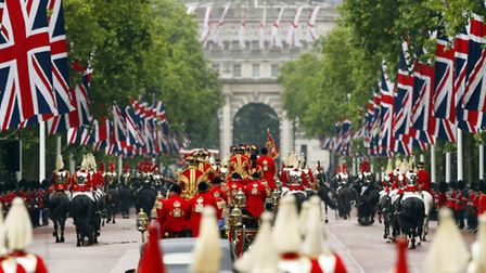 The new carriage carrying Queen Elizabeth II and The Duke of Edinburgh leaves Buckingham Palace, Lon