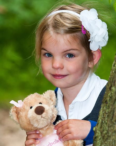 Tallula Twiddy, 6, with her ballerina bear on a nature walk.