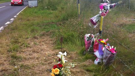 Floral tributes laid at the scene of the fatal collision on the A146 at Thurton.