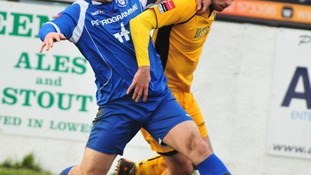 Lowestoft Town defender Sam Gaughran has signed a two-year deal at Crown Meadow.