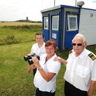Happisburgh Coast Watch. Left to right, trainees Paul and Jacqui Hayter with chairman and station co