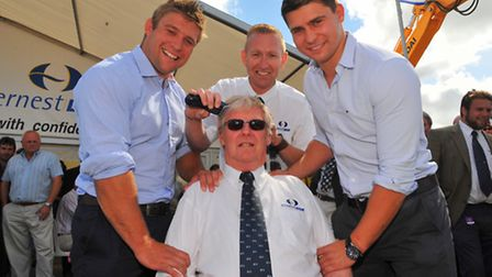 Close shave. David Norris getting his head shaved for the Big C on the Ernest Doe stand at the Royal