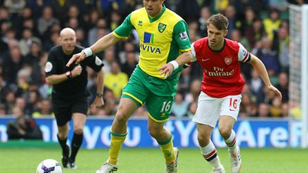 Johan Elmander of Norwich and Aaron Ramsey of Arsenal in action during the Barclays Premier League m