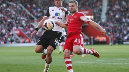 Luke Shaw of Southampton clears the ball under pressure from Johan Elmander of Norwich City during t