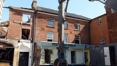 The demolition has started on the former Aldiss building in Fakenham town centre, after it was destr