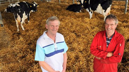 Herdsman Ian Briggs, left, and fitter, Terry Emms, who have both worked at Guilt Cross Dairy at Kenn
