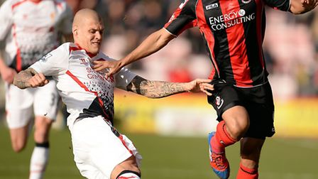 Norwich City's new striker Lewis Grabban in action for Bournemouth last season. He remains the Canar