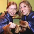 Anna Brady and Molly Knapp-Taylor with the hair they have donated to children's charity The Little P