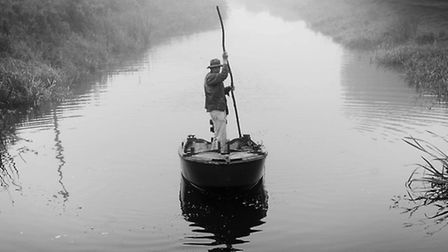 Peter Carter sets out to trap eels on a misty mornning in the fens.