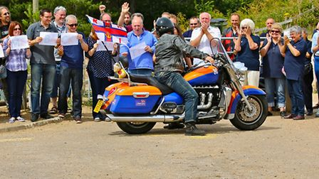 Matt Hawkes is cheered into Wells after competing his epic ride around Britain for the RNLI