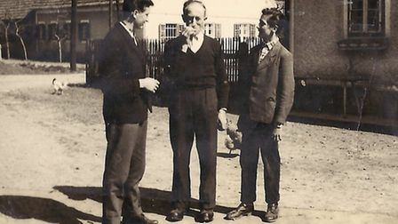 Karl, left, and his brother Anton, right, with their uncle.
