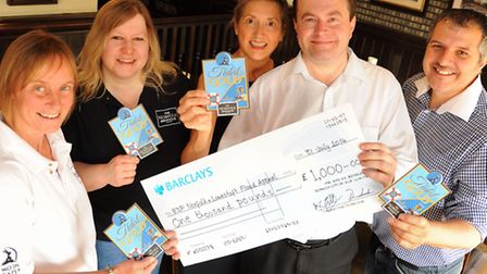 David Bale, EDP reporter, with the cheque for £1000 from City of Ale organisers for the EDP Norfolk