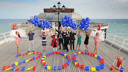 Cromer Pier supporters and summer show dancing girls celebrate 200 years of piers.Picture: ANTONY KE