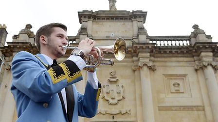 A fanfare is played by members of the Fairey Brass Band outside the Lynn Corn Exchange to mark the s