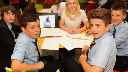 School children at work on their presentations with business mentors, as part of the Pecha Kucha wor