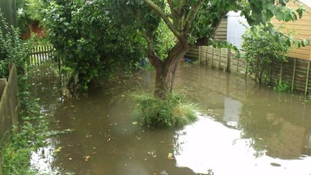 A Bungay garden flooded after Sunday's deluge.